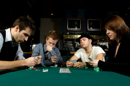 Four friends playing poker